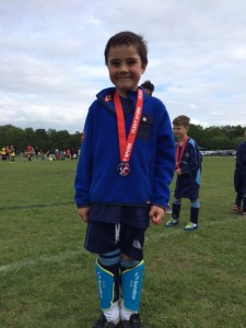 An U6 Mini Ranger Sporting His Medal At The End Of A Great Festival!