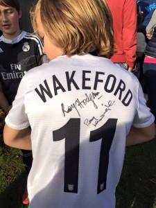 Ethan (U11 Dinamo) proudly sports his signed shirt