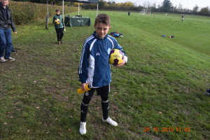 Marc, U12 Warriors, arrives with sponsored football and bags of enthusiasm!