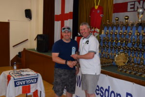 Nick Reynolds, Outgoing CDO, Receives His Committee Award From Brian Slyfield
