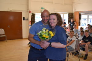 U12 Warriors Manager Dan Wheatley Presents a Bouquet to Team Rep Margaret Wickham