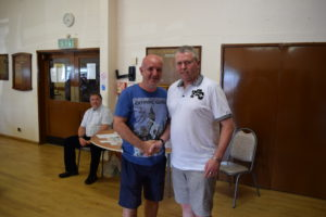 U15 Coach Andy Barry Receives a 10-Year Long Service Award From Brian Slyfield